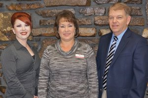 Submitted Photo Pictured at Grand Savings Bank are: Lisa Munoz, consumer loan officer; Carla Martinez, Gentry and Decatur market president; and Kevin Rieff, vice president.
