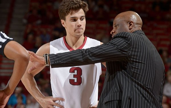 Arkansas coach Mike Anderson talks to guard Dusty Hannahs during a game against Charleston Southern on Friday, Nov. 20, 2015, at Bud Walton Arena in Fayetteville.