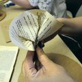 Pages are folded into a cone or flower shapes. Folding can be done in any fashion the creator choose...