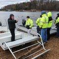 Tony Lumpkin (left), boat designer, explains Saturday Nov. 21, 2015 the features of two rescue boats...