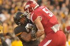 Arkansas linebacker Brooks Ellis tackles Missouri running back Marcus Murphy during a game Friday, Nov. 28, 2014, at Faurot Field in Columbia, Mo.