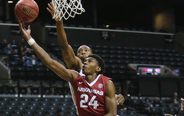 Arkansas's Jimmy Whitt (24) drives past Georgia Tech's James White (33) during the first half of an NCAA college basketball game Thursday, Nov. 26, 2015, in New York. (AP Photo/Frank Franklin II)