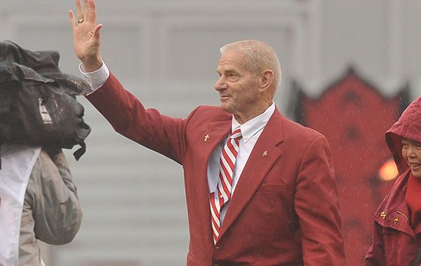 Former Arkansas baseball coach Norm DeBriyn is recognized prior to a football game between Arkansas and Missouri on Friday, Nov. 27, 2015, at Razorback Stadium in Fayetteville.