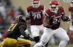 Arkansas' Kody Walker (24) looks to dodge past Missouri's Ian Simon (21) during the first half of an NCAA college football game Friday, Nov. 27, 2015, in Fayetteville, Ark. (AP Photo/Samantha Baker)