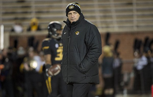 Missouri head coach Gary Pinkel watches his team warm up before an NCAA college football game against Tennessee, Saturday, Nov. 21, 2015, in Columbia, Mo., the final home game for Pinkel as head coach of Missouri. (AP Photo/L.G. Patterson)