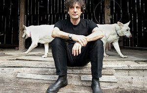 Best-selling author Neil Gaiman, 49, sits at an old barn near his writing gazebo at his home in western Wisconsin.