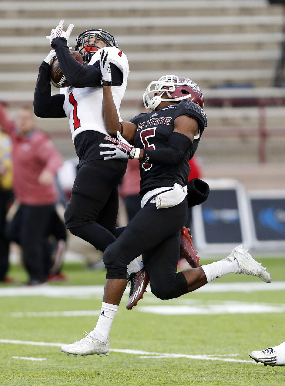 Arkansas State defensive back Blaise Taylor (left ...