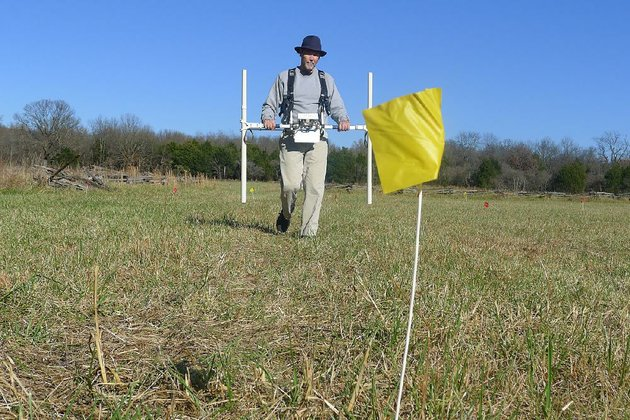 jami-lockhart-director-of-remote-sensing-for-the-arkansas-archeological-survey-uses-a-gradiometer-to-look-for-artifacts-thursday-at-ruddicks-field-at-pea-ridge-national-military-park