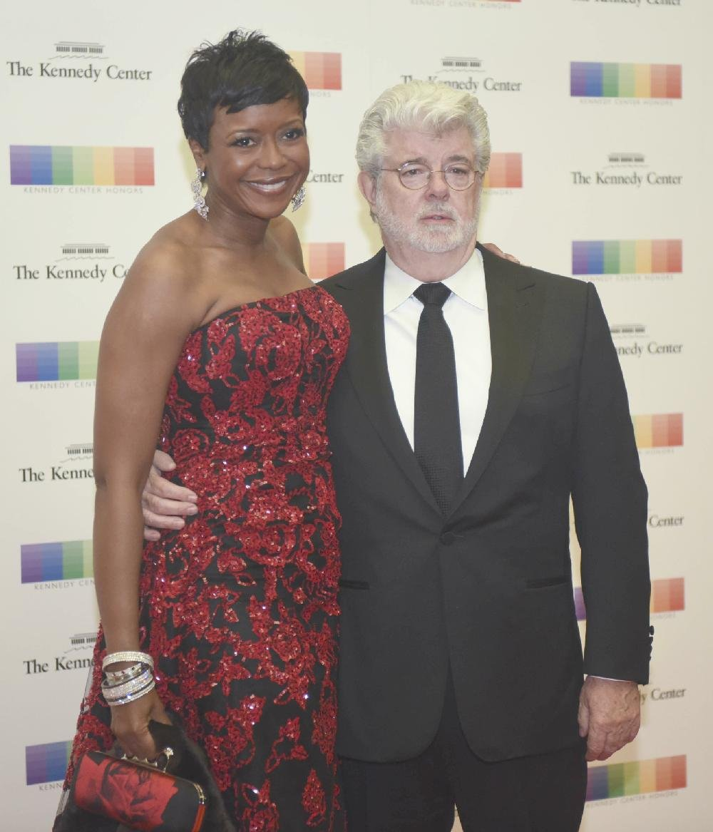2015 Kennedy Center Honoree Filmmaker George Lucas And His Wife Mellody Hobson Pose On The Red Carpet At State Department Dinner For