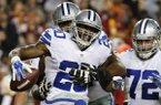 Dallas Cowboys running back Darren McFadden (20) celebrates his touchdown during the second half of an NFL football game against the Washington Redskins in Landover, Md., Monday, Dec. 7, 2015. The Cowboys defeated the Redskins 19-16. (AP Photo/Alex Brandon)