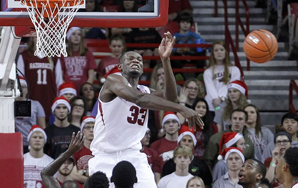 Arkansas' Moses Kingsley (33) blocks a shot during the first half of an NCAA college basketball game against Tennessee Tech, Saturday, Dec. 12, 2015, in Fayetteville, Ark. (AP Photo/Samantha Baker)