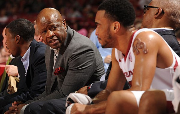 Arkansas coach Mike Anderson (left) speaks with Jabril Durham on the bench against Tennessee Tech Saturday, Dec. 12, 2015, during the second half at Bud Walton Arena.