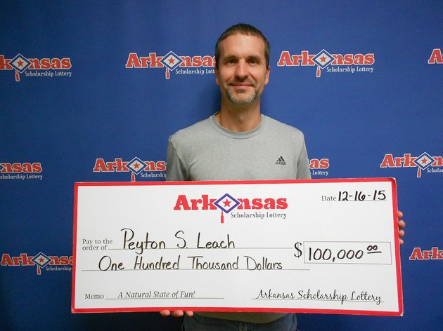 mountain-home-resident-peyton-leach-holds-his-100000-check-from-the-arkansas-scholarship-lottery