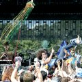 Hundreds of bands performed during the Wakarusa music festival, including Andy Frasco, center, crowd...