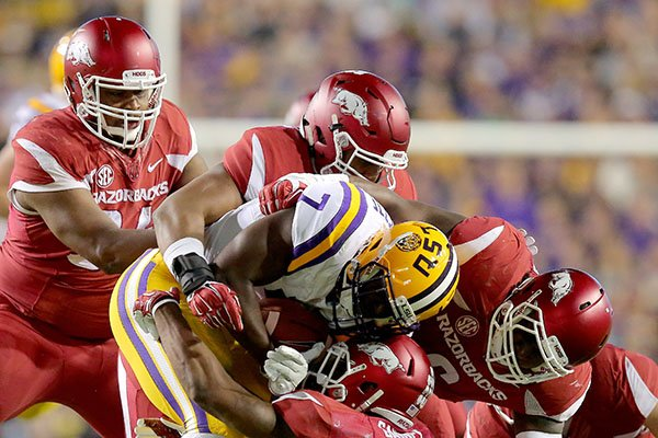 Arkansas defenders tackle LSU running back Leonard Fournette during a game Saturday, Nov. 14, 2015, at Tiger Stadium in Baton Rouge, La.