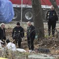 Springdale police and the Washington County Coroner look at a body found in a creek near Randall Wob...