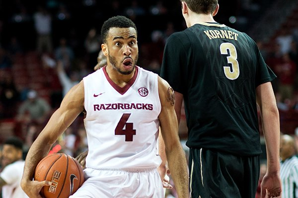 Arkansas' Jabril Durham (4) reacts to the crowd after a turnover in the final seconds of the game to give Arkansas possession of the ball in the second half of an NCAA college basketball game against Vanderbilt in Fayetteville, Ark., Tuesday, Jan. 5, 2016. Arkansas won 90-85 in overtime. (AP Photo/Sarah Bentham)