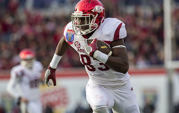 Arkansas tight end Jeremy Sprinkle (83) runs with the ball following a reception during the second quarter on Saturday, Jan. 2, 2016, at the Liberty Bowl in Memphis, Tenn.