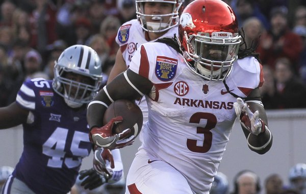 Arkansas running back Alex Collins ran 185 yards and three touchdowns during the Razorbacks' 45-23 Liberty Bowl victory over Kansas State Saturday, Jan. 2, 2016, in Memphis.