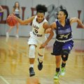 Springdale High's Kierra Lang (5) drives Friday against Fayetteville defender DaShundra Morgan in Sp...
