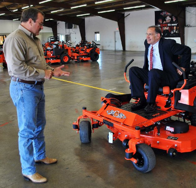 scott-lancaster-left-general-counsel-for-bad-boy-mowers-in-batesville-discusses-the-companys-products-with-us-sen-john-boozman-the-company-has-received-millions-of-dollars-in-incentives-from-the-arkansas-economic-development-commission