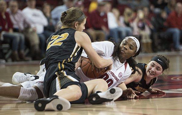 Arkansas' Jessica Jackson (00) struggles for possession of the ball with Missouri's Jordan Frericks (22) and Juanita Robinson on Sunday, Jan. 17, 2016, at Bud Walton Arena in Fayetteville. Arkansas won 64-52.