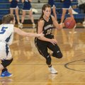 Madison Brittain, Bentonville senior guard, slips Friday past the grasp of Emma Wisdom, Rogers High ...