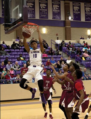 News-Times/Faith Lightsy El Dorado's Daniel Gafford (10) dunks during the Wildcats' 6A-South clash against Pine Bluff on Tuesday at Wildcat Arena.