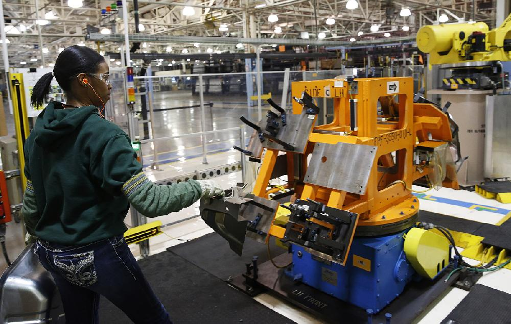 An Autoworker Assembles Parts That Will Be Welded By A