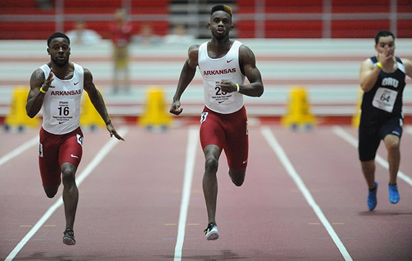 Jarrion Lawson (center) of Arkansas leads Ryan Green (left) and Daniel Enriquez of Oral Roberts in the 60 meters Friday, Jan. 15, 2016, during the Arkansas Invitational at the Randal Tyson Track Center.
