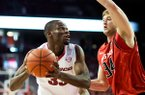 Arkansas' Moses Kingsley (33) looks to the basket as Texas Tech's Matthew Temple (34) defends in the first half of an NCAA college basketball game in Fayetteville, Ark., Saturday, Jan. 30, 2016. (AP Photo/Sarah Bentham)