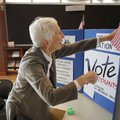 Joyce Hale, with the League of Women Voters of Washington County, prepares her booth Friday at the F...
