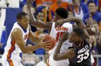 Florida guard KeVaughn Allen (4) grabs a rebound away from Arkansas forward Moses Kingsley (33) during the second half of an NCAA college basketball game at the O'Connell Center on Wednesday, Feb. 3, 2016 in Gainesville, Fla. Florida defeated Arkansas 87-83. (Matt Stamey/The Gainesville Sun via AP)