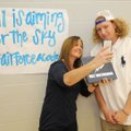 Eli Hale (right) smiles Wednesday as he takes a photo with his mother, Kiersten Hale, after he signe...