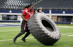 Former Arkansas running back Alex Collins participates in the Marines obstacle course at the All-Star Football Challenge on Tuesday, Feb. 2, 2016, at AT&T Stadium in Arlington, Texas. The event was aired Friday, Feb. 5, 2016, on ESPN2.