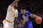 Kentucky guard Jamal Murray (23) drives against Tennessee guard Kevin Punter (0) during the first half of an NCAA college basketball game Tuesday, Feb. 2, 2016, in Knoxville, Tenn. (AP Photo/Wade Payne)