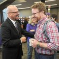 Matthew Wendt (left), newly hired superintendent of Fayetteville Schools, laughs Friday with Clay Mo...