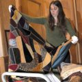 Terrilyn Wendling, assistant director at the Rogers Historical Museum, looks at quilts Tuesday in th...