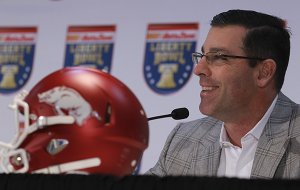 Arkansas offensive coordinator Dan Enos speaks to the media during a press conference Thursday, Dec. 31, 2015, at the Embassy Suites hotel in Memphis, Tenn.