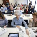 Deborah Tuttle (from left), Linda Myers and Cheryl Duncan, election poll workers, participate in tra...