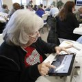 Virginia Lewis, a election poll worker, participates in training Tuesday by the Washington County El...
