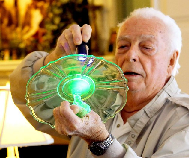 the-uranium-in-a-vaseline-depression-era-glass-dish-glows-green-as-bud-martin-hits-it-with-a-beam-of-ultraviolet-light-martin-is-chairman-of-the-arkansas-glasshoppers-depression-era-and-vintage-glass-show-and-sale-on-saturday-and-feb-28-at-the-state-fairgrounds