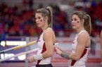 Tori Weeks (left) and Lexi Weeks of Arkansas prepare to compete in the pole vault invitational on Saturday, Feb. 13, 2016, during the second day of the Tyson Invitational indoor track meet at the Randal Tyson Track Center in Fayetteville.