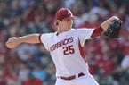 Dominic Taccolini of Arkansas delivers against Central Michigan Friday, Feb. 19, 2016, at Baum Stadium in Fayetteville.