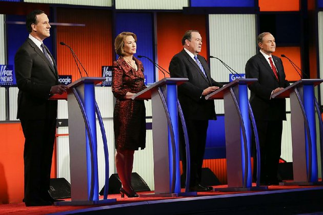 former-arkansas-gov-mike-huckabee-second-from-right-joins-the-field-of-republican-presidential-candidates-debating-jan-28-in-des-moines-iowa-the-others-on-stage-are-from-left-former-us-sen-rick-santorum-business-executive-carly-fiorina-and-former-virginia-gov-jim-gilmore