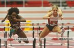 Arkansas' Payton Stumbaugh, right, competes against Mississippi State's Ste'yce McNeil in the 60 meter hurdles during the SEC Indoor Championships on Friday, Feb. 26, 2016, at Randal Tyson Track Center in Fayetteville.