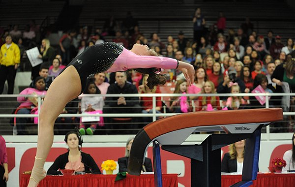 Arkansas' Sydney McGlone competes Friday, Feb. 26, 2016, in the vault portion of the Razorbacks' meet with Kentucky in Barnhill Arena in Fayetteville.