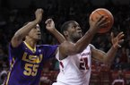 LSU's Tim Quarterman (55) chases Arkansas' Manuale Watkins (21) as Watkins goes in for a layup during the first half of an NCAA college basketball game Tuesday, Feb. 23, 2016, in Fayetteville, Ark. (AP Photo/Samantha Baker)