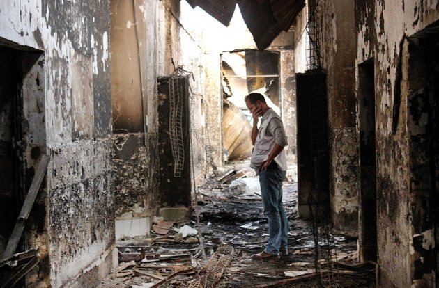 an-employee-of-doctors-without-borders-walks-inside-the-charred-remains-of-the-organizations-hospital-after-it-was-hit-by-a-us-airstrike-in-kunduz-afghanistan