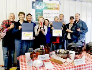 TIMES photograph by Annette Beard Lost Bridge Community Church earned first place in the People's Choice for the 12th annual Chili Cook-off sponsored by the Northeast Benton County Volunteer Fire Department Saturday. See pg. 6A for more.